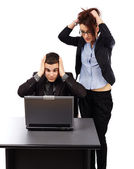 Young businesspeople having trouble with their laptop — Stock Photo