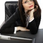 Closeup of businesswoman with laptop — Stock Photo