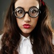 Closeup of geeky schoolgirl - Stock Photo