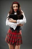 Smiling schoolgirl in closeup — Stock Photo