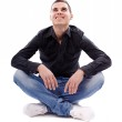Young man sitting cross legged — Stock Photo #21556415