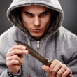 Closeup pose of a dangerous gangster — Stock Photo