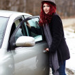 Redhead opening the door to her car — Stock Photo
