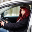 Young girl sitting in a car — Stock Photo
