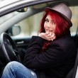 Young girl sitting in the car — Stock Photo