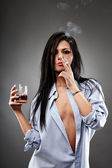 Sexy woman smoking and drinking — Stock Photo
