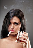 Young woman smoking and drinking — Stock Photo