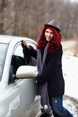 Pretty girl closing the door to her car — Stockfoto