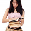 Young Latino schoolgirl reading — Stock Photo #22301665