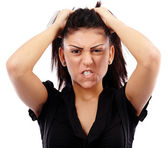 Angry businesswoman pulling her hair — Stockfoto