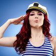 Cute female sailor saluting — Stock Photo #22495933