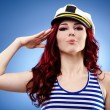 Stock Photo: Cute female sailor saluting