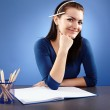 Young student sitting at her desk — Stock Photo #22495975