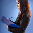 Profile pose of a young businesswoman — Stock Photo #23794301