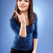 Young woman scolding and pointing finger — Stock Photo #23794381