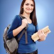 Student girl with backpack and books — Stock Photo #23794411