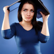 Stressed woman covering her head with her laptop — Stock Photo #23794459