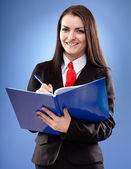 Smiling businesswoman holding a notebook — Stock Photo
