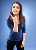 Young woman scolding and pointing finger — Stock Photo