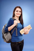 Student girl with backpack and books — Stock Photo