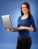Young woman holding a laptop — Stok fotoğraf