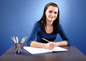 Closeup pose of young student sitting at her desk — Stock Photo