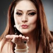 Beautiful woman blowing a kiss — Stock Photo