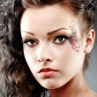 beautiful woman with fantasy makeup — Stock Photo