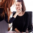 Stock Photo: Makeup artist applying makeup