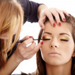 Постер, плакат: Makeup artist applying makeup