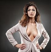 Sexy businesswoman on gray background — Stock Photo