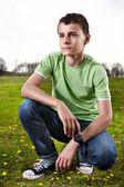Young boy posing outdoors — Stock Photo