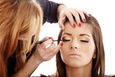 Makeup artist applying makeup — Stock Photo
