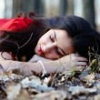 Beautiful woman sleeping on the ground in the woods — Stock Photo