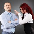 Businessman ignoring angry businesswoman — Stockfoto