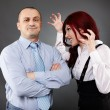 Businessman ignoring angry businesswoman — Stock Photo #25747021