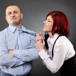Businesswoman pulling businessman's necktie — Stok fotoğraf