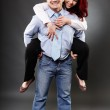 Businessman carrying his partner in the back — Stock Photo