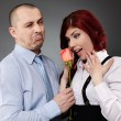 Businessman giving a rose to his partner — Stockfoto