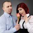 Businessman giving a rose to his partner — Foto de Stock