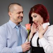 Businessman giving a rose to his partner — Foto Stock