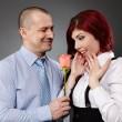 empresário dando uma rosa ao seu parceiro — Foto Stock