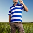 Young man standing in a wheat field — Stock Photo