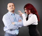 Businessman ignoring angry businesswoman — Stock Photo