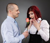 Businessman giving a rose to his partner — Stock Photo
