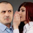 Businesswoman whispering in her boss' ear — Stock Photo