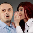 Businesswoman whispering in her boss' ear — Foto Stock
