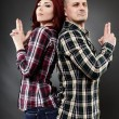 Young couple back to back — Stockfoto