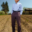 Senior farmer standing outdoor — Stock Photo
