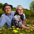 Old couple resting outdoor — Stock Photo